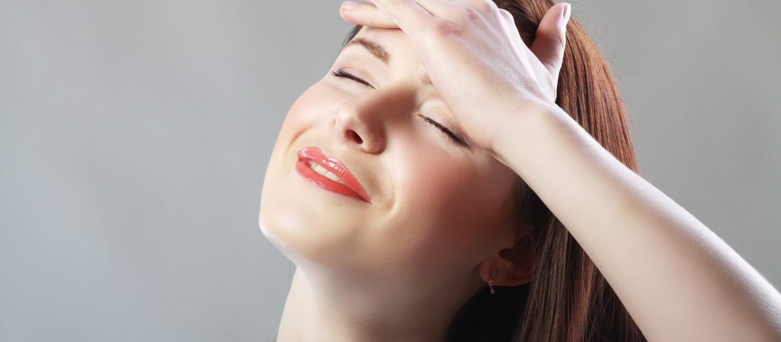 Young woman stressed have a head pain and feels releaf after pain