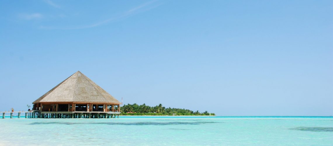 beautiful tropical beach and wooden bungalow in Maldives